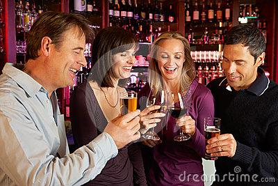 Group Of Friends Enjoying Drinks Together In Bar