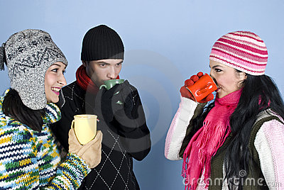 Group friends enjoying a hot drink together