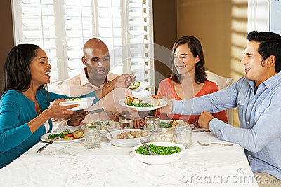 Group Of Friends Enjoying Meal At Home