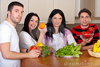 Group of friends with fruits and vegetables