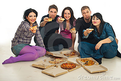 Group of friends giving pieces of pizza
