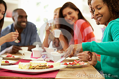 Group Of Friends Having Cheese And Coffee At Dinner Party