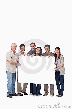 Group of friends holding blank sign together