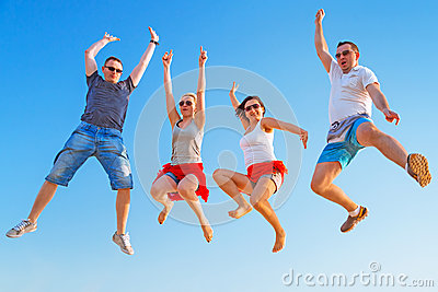 Group of friends jumping with happiness