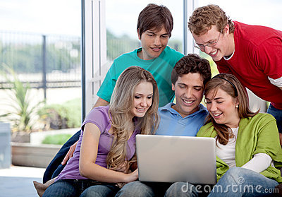 Group of friends with a laptop
