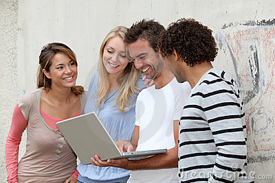 Group of friends with laptop
