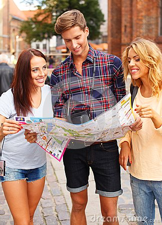 Group of friends with map