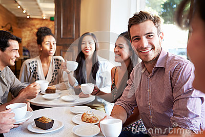 Group Of Friends Meeting In Cafe Restaurant