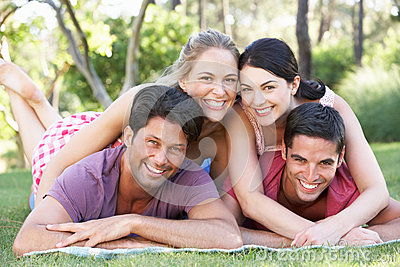 Group Of Friends Relaxing In Park Together