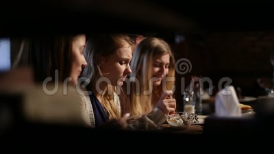 Group of girls meeting for lunch at restaurant stock video