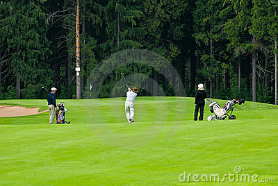 Group golfers on golf feeld Editorial Stock Image