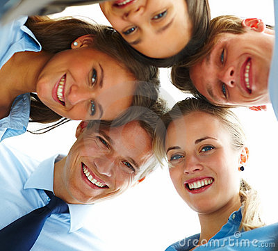 Group of happy business people standing in circle