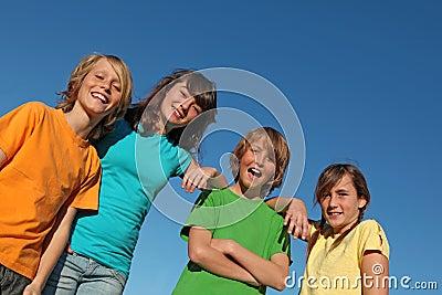 Group of happy smiling kids or tweens