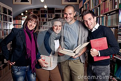 Group of happy students at a library