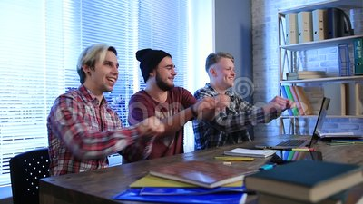 Group of happy students showing triumph gesture stock video footage