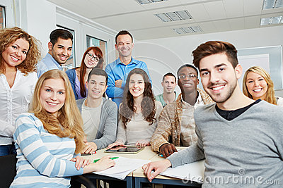 Students with teacher and tablet