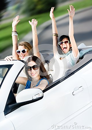 Group of happy teenagers in the white car