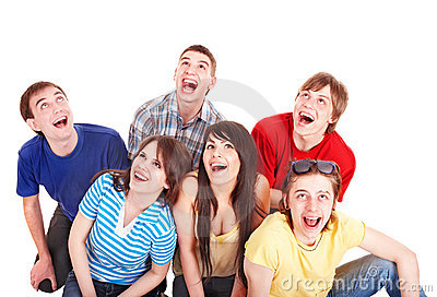 Group of happy young people looking up.