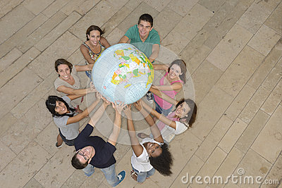 Group holding  the Earth Globe showing Africa