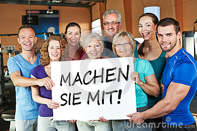 Group holding German sign