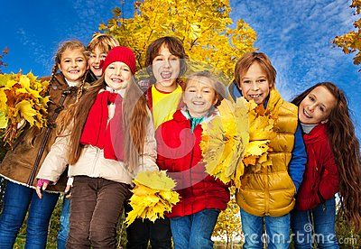 Group kids in autumn park