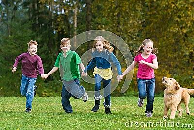 Group of kids having fun running
