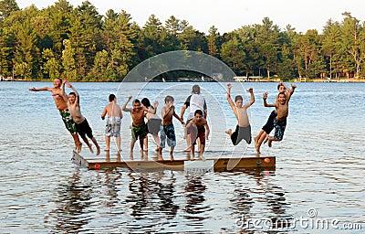 Group of kids jump into Lake