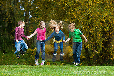 A group of kids jumping in the air