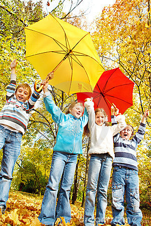 Group of kids with umbrellas