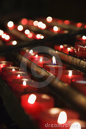 Group of lit church candles.