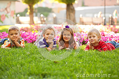 Group of little children relaxing  in park