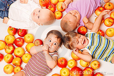 Group lying in apples