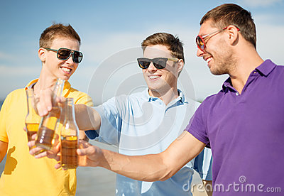 Group of male friends having fun on the beach