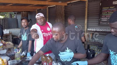 Group of man preparing cocktail drink in their stalls in Fourways Farmers Market, Johannesburg, South Africa 股票录像