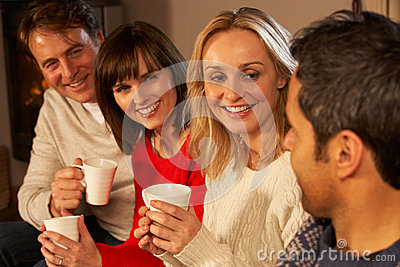 Group Of Middle Aged Couples With Hot Drinks