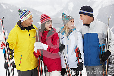 Group Of Middle Aged Couples On Ski Holiday