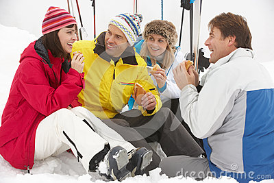Group Of Middle Aged Friends Eating Sandwich