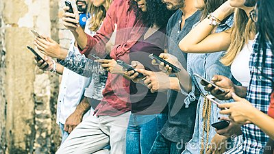 Group of multicultural friends using mobile smart phone Stock Photo