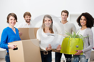 Group of multiethnic friends helping to move house