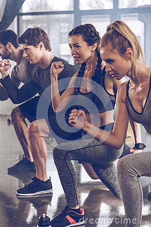 Free Group Of Athletic Young People In Sportswear Doing Lunge Exercise At The Gym Royalty Free Stock Photography - 94306717