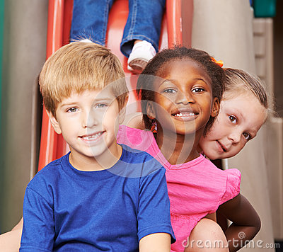 Free Group Of Children Sitting Behind Each Other Royalty Free Stock Image - 61671376