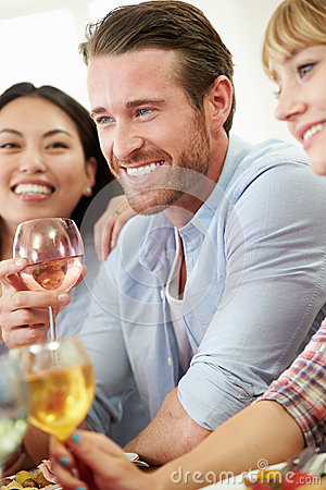 Free Group Of Friends Sitting Around Table Having Dinner Party Royalty Free Stock Photo - 35610545