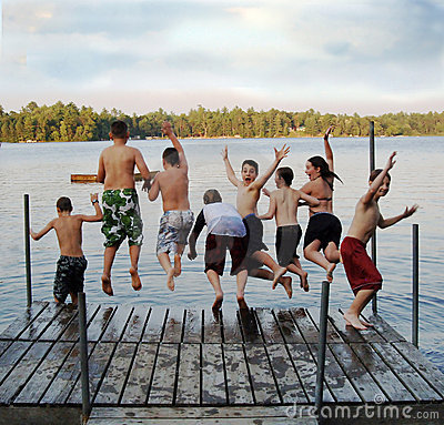 Free Group Of Kids Jumping Into Lake Royalty Free Stock Image - 6604726