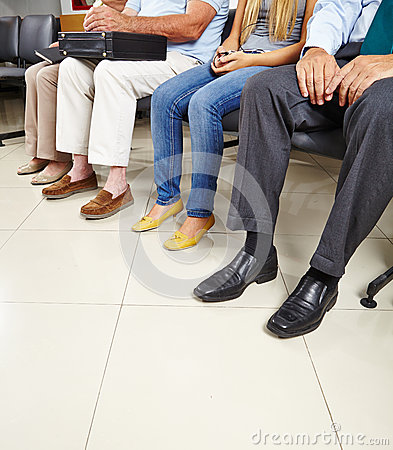 Free Group Of Patients In Waiting Room Royalty Free Stock Photos - 33010788