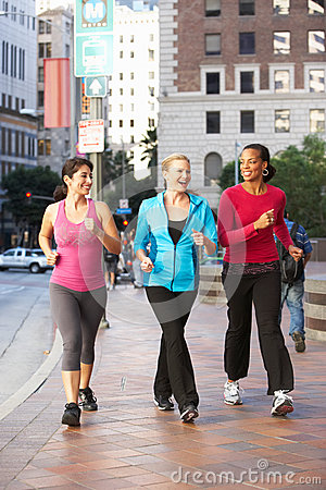 Free Group Of Women Power Walking On Urban Street Royalty Free Stock Photos - 30211898