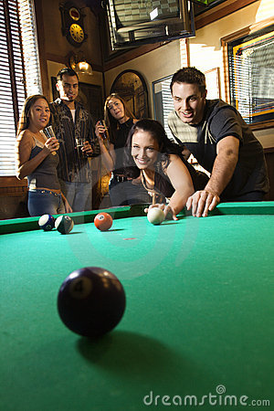 Free Group Of Young Adults Playing Pool. Stock Image - 2037211