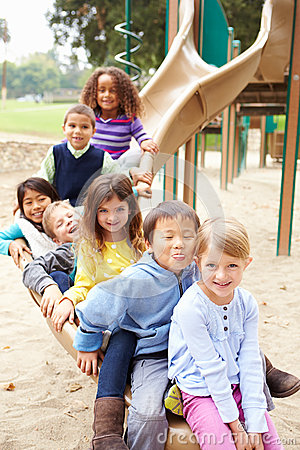 Free Group Of Young Children Sitting On Slide In Playground Royalty Free Stock Image - 55901276