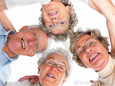 Group of old people with their heads together
