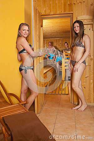 Group of people in front and in a sauna