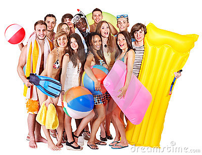 Group people holding beach accessories.